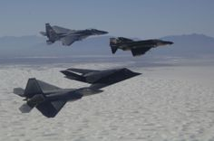 An F-15 Eagle, F-4 Phantom, F-117 Nighthawk, and F-22 Raptor fly in formation over Holloman Air Force Base, NM during the Holloman Air and Space Expo on October 27, 2007. The HASE is a showcase of Air Force capabilities, the 49th Fighter Wing mission and the X Prize Foundation. (U.S. Air Force photo by Senior Airman Russell Scalf)