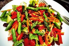 Healthy Salad: Romaine lettuce, cherry tomatoes, red bell peppers, avocado, asparagus, carrots, cranberries, black sesame seeds.
