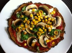 Healthy sweet potato base pizza. Topped with tomato passata, cottage cheese, spinach, capers, mushroom & sweetcorn.  The base is 1 sweet potato steamed in its skin the microwave for 6mins. Then peel off the skin and mix the potato with 1 egg and about 5tbs of flaxseed so that it becomes thicker. Then I spread the mixture on a baking sheet and cooked for 15 mins then turned it over to cook the under side for a further 8-10mins. Then base is done and you can add whatever you want on top.