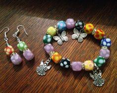 Perlas multicoloras con encantos por JacksJewelryArt en Etsy