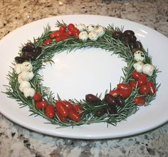 Fresh cut rosemary from the garden and formed into a wreath turned out to be the perfect foundation for a Christmas party appetizer. I just added petite tomatoes, black olives and marinated mozzarella balls from Trader Joe's for a festive touch!