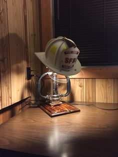 Fire helmet display with lamp Firefighter Room, Firefighter Home Decor, Firefighter Pictures, Volunteer Firefighter, Firefighters Wife, Firemen, Fire Dept, Fire Department, Fire Hose Projects