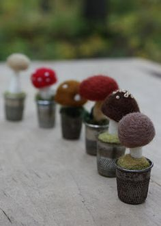 Felted mushrooms in thimbles.  Cute idea.