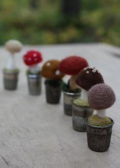 Felted mushrooms in thimbles.  Cute idea.
