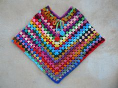 The completed über poncho. http://www.ravelry.com/projects/crochetbug13/groovy-granny-poncho