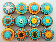 Set of 12 Aqua blue and yellow mandala print wood knobs are 1.5 wide and have been stained English Chestnut with a decoupage mandala pattern. Sealed with a triple coat gloss finish so these knobs are durable enough for everyday use on your cabinets or furniture. Mounting screws included, these wood knobs feature a brass insert to ensure a secure fit when attaching the enclosed screws.