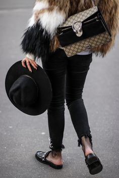 black hat and open loafers