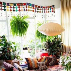 Bohemian spaces are often filled with a sense of wanderlust and adventure. Photo via Harper's Bazaar.