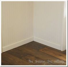 instead of walls with those funny strips running lengthwise, this person installed beaded boarding, moulding and wood floors