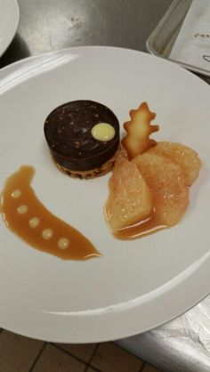 Grapefruit ganache atop a chocolate nibs with a grapefruit curd and grapefruit segments topped with caramel sauce
