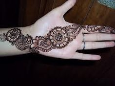 See more Long henna flower fashions on the front side of the hand and finger