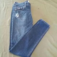 Hollister distressed dark wash jeans Very cute ...good condition distressed jeans ...make an offer !! Hollister Pants Skinny