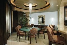 Cascade Round by Boyd Lighting, featured in a dining room by Hart Hempelmann
