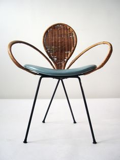 1950's French Modernist Fleur-de-Lis Chair. This 1950s Modernist chair features a lyrical Fleur-de-Lis composition of iron, cane, and skai
