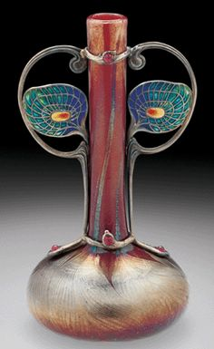 Tiffany Vase with Peacock Feather Plique-a-Jour Mount...but I can't help but see a face of an alien