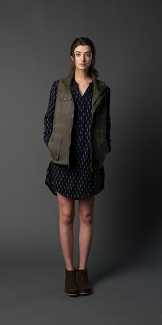 """An easy-going long-sleeved shirt dress for fall with a stand collar, gathered shoulder detail and a half-button placket. In Navy Brush Print. 50% Cotton 50% Rayon. Model is 5'9"""" and wearing a size Sma"""