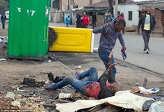 Under siege:The brutal attack was captured on camera on Saturday morning by a journalist from South Africa's Sunday Times newspaper who was in the neighbourhood to interview a number of foreign-born shopkeepers who'd had their businesses looted overnight