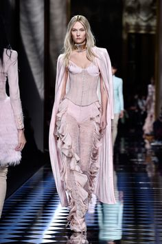 The Balmain show of the Paris Fashion Week Womenswear Fall/Winter 2016/2017 on March 3, 2016. This piece was out, which is a pink corset pairing with a flounce long pants. The style of using corset might be inspired by the 1910s corset trend style. However, instead of white, it is pink. ---------Chung Chi Chan. week 9. for checkpoint 3/23
