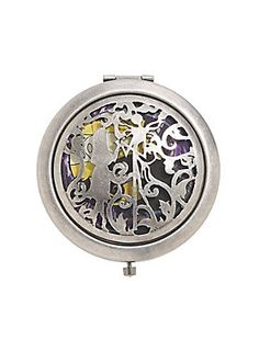 "<div>Just like Jack and Sally, you and this hand mirror are truly meant to be. The burnished silver hinge mirror from <i>The Nightmare Before Christmas</i> has a die-cut front of Jack and Sally holding hands on a colorful Spiral Hill background. </div><div><ul><li style=""list-style-position: inside !important; list-style-type: disc !important"">Metal</li><li style=""list-style-position: inside !important; list-style-type: disc !important"">2 3/4"" diameter</li><li style=""list-style-position..."