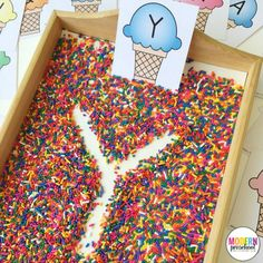 Ice Cream & Sprinkles Alphabet Writing Practice Free printable ice cream alphabet cards for this super simple writing tray filled with sprinkles! Practice pre-writing and fine motor skills. Kindergarten Literacy, Preschool Classroom, Preschool Learning, Writing Center Preschool, Classroom Decor, Letter Activities, Literacy Activities, Activities For Children, Phonological Awareness Activities