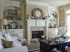 Transitional Living Room Home Decor--beautiful fireplace and mirror focal point with neutral color scheme