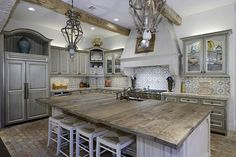 Kitchen: love the rustic look with the brick floor and the cabinets.