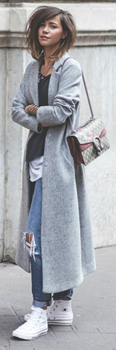 Zoé Alalouch + sophisticated street style + sleek marl grey maxi coat + attractively + pair of distressed denim jeans + dark tee + white trainers + increases the contrast + adds yet another dimension to the style. Jacket: New Look, Top: American Vintage, Jeans: Mango, Shoes: Converse.