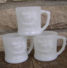 Vintage Johnny Hart BC Comics Fireking Milk Glass Grog Mugs....we had a couple of these glasses when I was little...I really liked that cup..