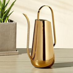 Shop brass watering can. We love beautiful, practical things. Stunning in silhouette, handmade vessel shines bright in brass-plated stainless steel. Water your plants and don't bother to put it away. Too lovely to hide. brass watering can is a exclusive. White Planters, Modern Planters, Hanging Planters, Modern Vases, Brass Planter, Macrame Plant Holder, Modern Outdoor Furniture, Furniture Decor, Outdoor Decor