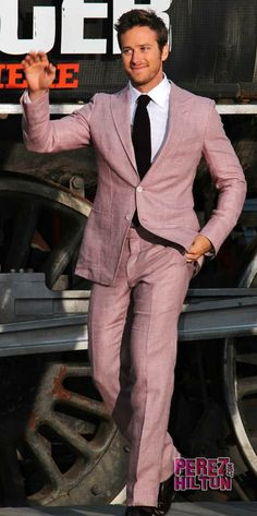Armie Hammer in soft pink suit.