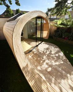 Fancy Unique Modern Storage Shed Office In The Backyard Garden Ideas With Glass Sliding Door And Half Tube Design Plus Wooden Ceiling Floor And Wall Design Idea