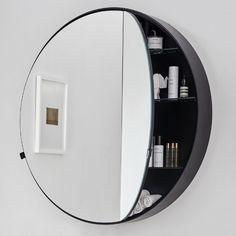 CIELO ROUND BOX MIRRORDouble compartment round container mirror with a lacquered body.cm Ø90x12Design Andrea Paradiso - Giuseppe Pezzano