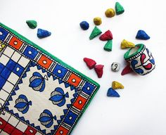 Ludo board game handcrafted from paper mache by Indian artisans