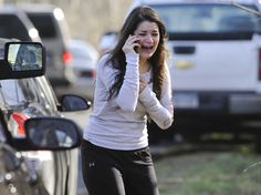 A woman waits to hear about her sister, a teacher, following a shooting at the Sandy Hook Elementary School in Newtown, Conn., about 60 mile...