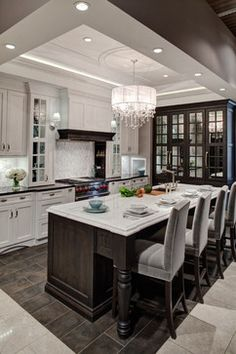 Our Lincolnwood showroom's kitchen remodel was inspired by the ornate light fixture glistening above the custom-edged island countertop. Kitchen Design, Kitchen Decor, Kitchen Ideas, Kitchen Display, Kitchen Styling, Kitchen Inspiration, Style Inspiration, Cocinas Kitchen, Beautiful Kitchens