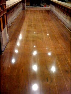 Concrete floors stained and stamped to look like wood
