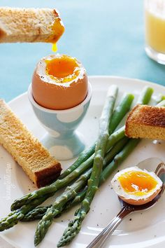 Eggs and Soldiers with Asparagus - As a child, I remember having soft boiled eggs for breakfast. My mom would serve it in a cute little egg holders and a mini spoons which is probably what started my obsession with egg holders. #kid #eggs