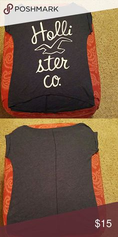 Hollister Tshirt Size XS.  Gray in color.  High low bottom.  Good condition. Hollister Tops Tees - Short Sleeve