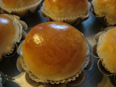 """This is another tasty bread recipe. Sweet-enough tender bread rolls filled with salty n' sweet """"overcooked"""" pork filling and then baked with a yolk-milk eggwash for that shiny an…"""