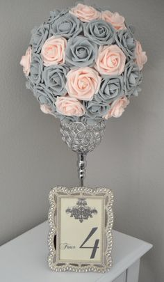 Are you thinking about having your wedding by the beach? Are you wondering the best beach wedding flowers to celebrate your union? Here are some of the best ideas for beach wedding flowers you should consider. Rose - You can't go wrong with a rose. Orange Wedding Flowers, Beach Wedding Flowers, Grey Flowers, Wedding Colors, Wedding Table Centerpieces, Diy Wedding Decorations, Flower Centerpieces, Centerpiece Ideas, Blush Centerpiece