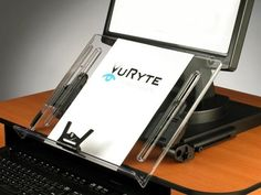 """The Vu Ryte 14KB Easel is 14"""" wide, and the surface is clear. The base frame is black and is designed to allow a monitor on a stand sit on top of it. Features:"""