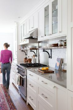 grey quartz countertops and off white cabinetry. Love the shelves under the cabinets.
