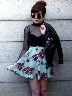 A black mesh shirt looks so cool when paired with a super feminine pieces, like this floral skirt.