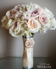 The feathery texture of this blushing bride #protea-filled #bouquet gives a soft…