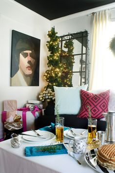 A potted spiral Christmas tree decorates a corner of a beautiful living room set up for Christmas brunch