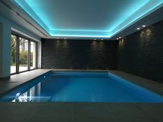 Coffered ceiling wth led RGB led strip in swimming pool design // By Annabelle Tugby Architects