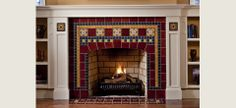 craftsman mantle surrounded by built in bookcases, fireplace