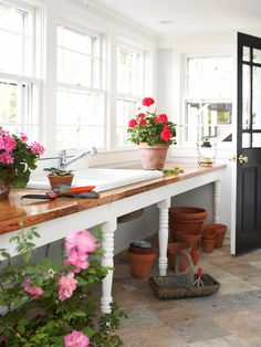 Potting room; love the wood counters and the space under for pots and potting materials that you can actually see. I think a brick floor in a herringbone pattern with a glossy, polished finish would be perfect for this look.