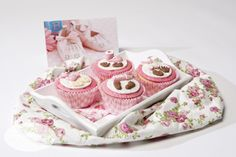 Cupcakes for a baby girl decorated with fondant using texture sheets and moulds