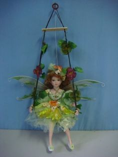Porcelain Doll: Jmisa 16 Porcelain Fairy Doll on Swing ** Continue to the product at the image link. Fairy Dolls, Plant Hanger, Porcelain Doll, Fairies, Green, Image Link, Painting, Art, Faeries